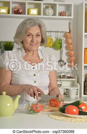 Senior woman cooking in kitchen - csp37360088