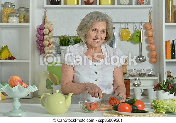 Senior woman cooking in kitchen - csp35809561