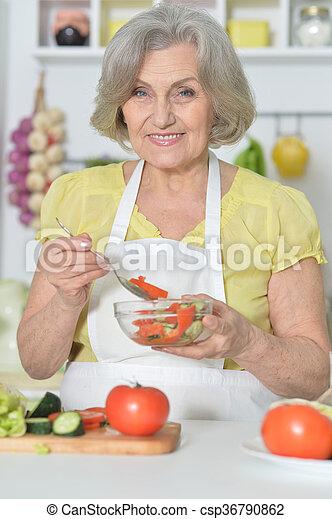 Senior woman cooking in kitchen - csp36790862