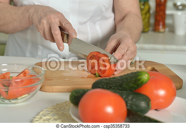 Senior woman cooking in kitchen - csp35358733