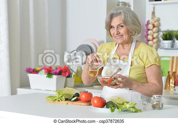 Senior woman cooking in kitchen - csp37872635