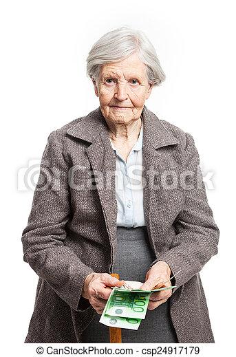 Senior woman counting money on white background - csp24917179