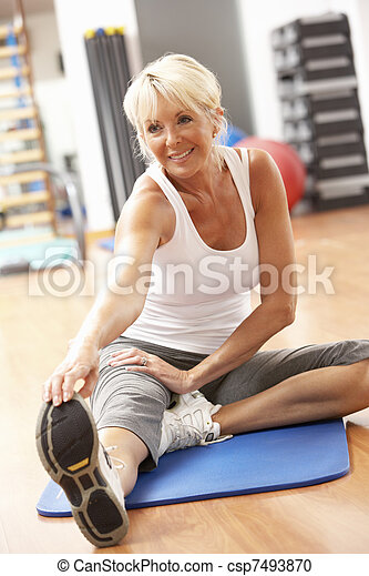 Senior Woman Doing Stretching Exercises In Gym - csp7493870