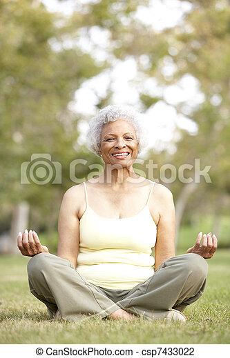 Senior Woman Doing Yoga In Park - csp7433022