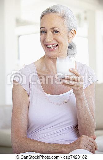 Senior Woman Drinking A Glass Of Milk - csp7420182