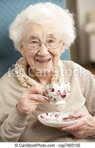 Senior Woman Enjoying Cup Of Tea At Home - csp7493105