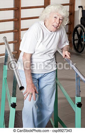 Senior Woman having ambulatory therapy - csp9927343