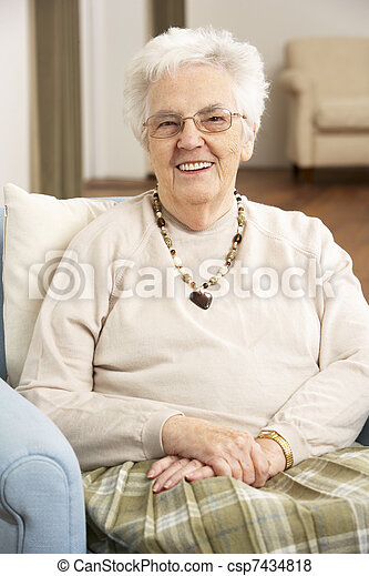 Senior Woman In Chair At Home - csp7434818