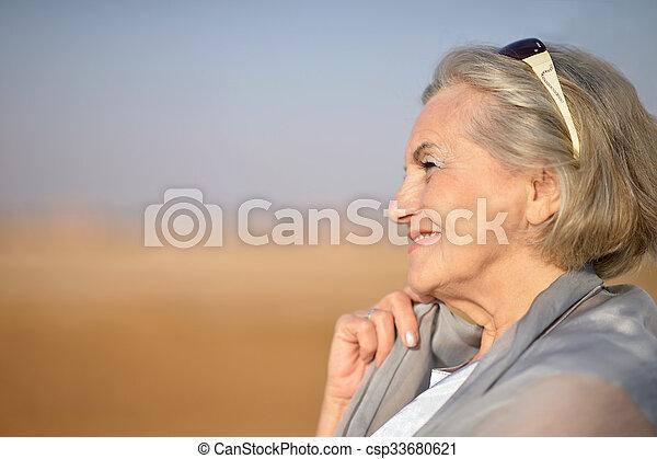 Portrait of a senior woman in desert