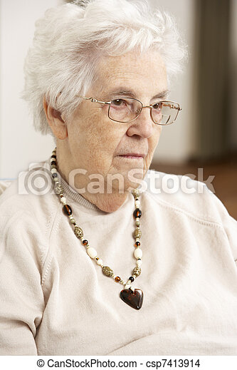 Senior Woman Looking Sad In Chair At Home - csp7413914