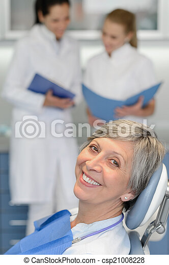 Senior woman patient at dentist surgery smiling - csp21008228