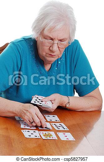 Senior woman playing cards - csp5827957