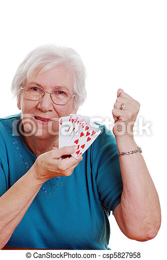 senior woman playing poker - csp5827958