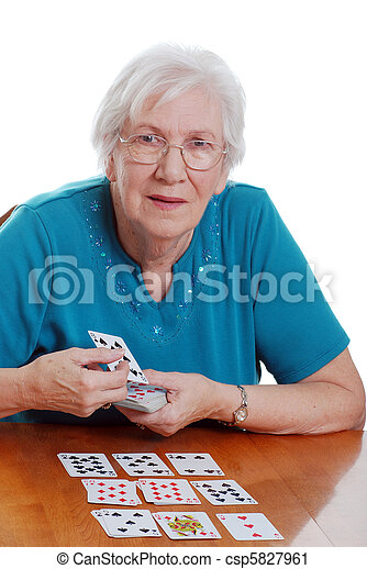 senior woman playing solitaire - csp5827961