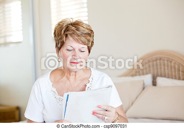 senior woman reading newspaper - csp9097031