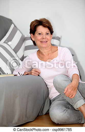 Senior woman relaxing at home - csp9961785