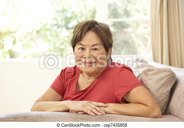 Senior Woman Relaxing In Chair At Home - csp7435858