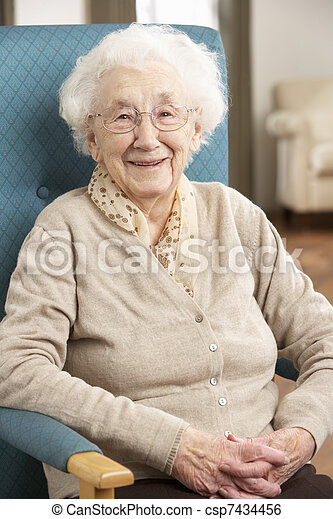 Senior Woman Relaxing In Chair At Home - csp7434456
