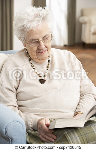 Senior Woman Relaxing In Chair At Home Reading Book - csp7428545