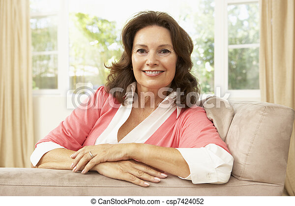Senior Woman Relaxing In Chair At Home - csp7424052