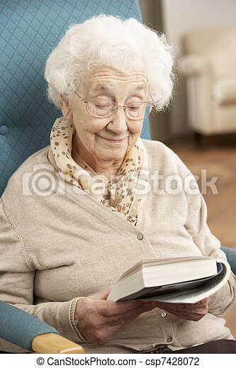 Senior Woman Relaxing In Chair At Home Reading Book - csp7428072