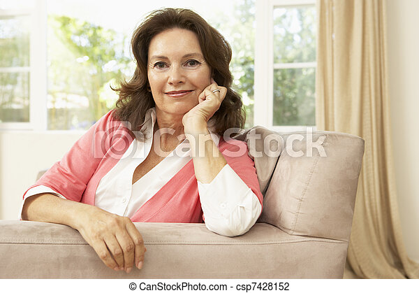 Senior Woman Relaxing In Chair At Home - csp7428152
