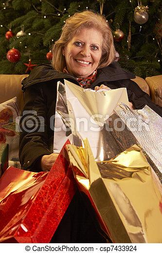 Senior Woman Returning After Christmas Shopping Trip - csp7433924