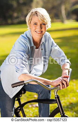 senior woman riding a bike - csp15357123