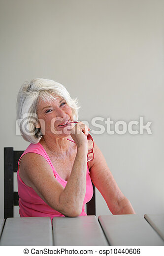 Senior woman sitting on her terrace - csp10440606