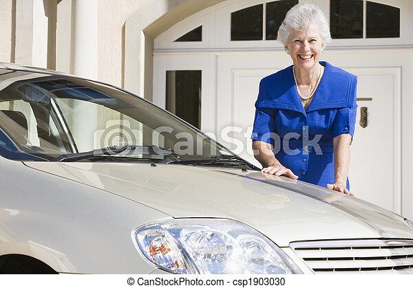 Senior woman standing next to new car - csp1903030