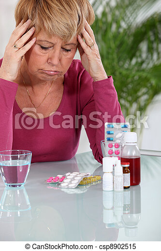 senior woman taking pills - csp8902515