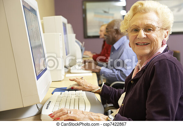 Senior woman using computer - csp7422867