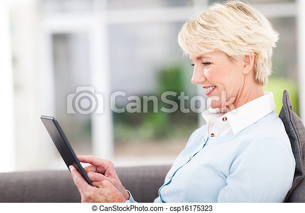 senior woman using tablet computer - csp16175323