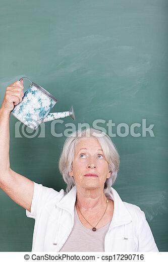 Senior woman watering her head - csp17290716