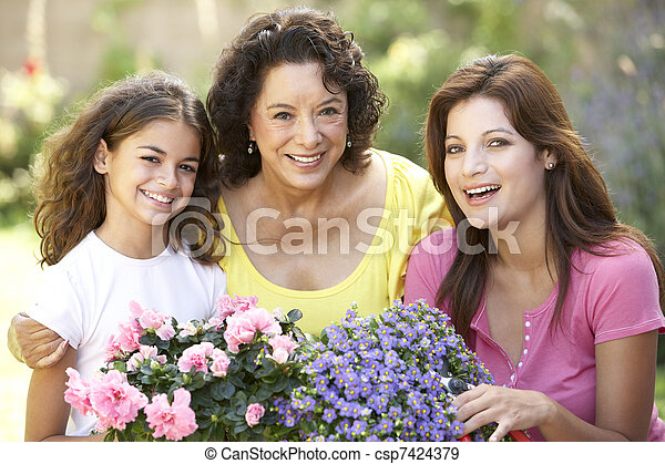 Senior Woman With Adult Daughter And Granddaughter Gardening Together - csp7424379