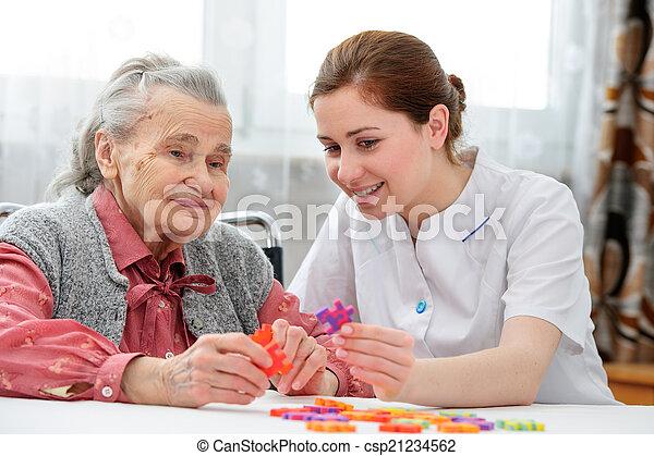 Senior woman with her elder care nurse - csp21234562