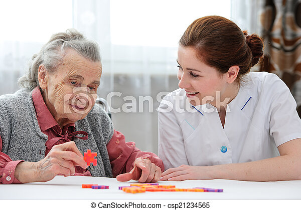 Senior woman with her elder care nurse - csp21234565