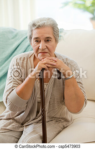 Senior woman with her walking stick - csp5473903