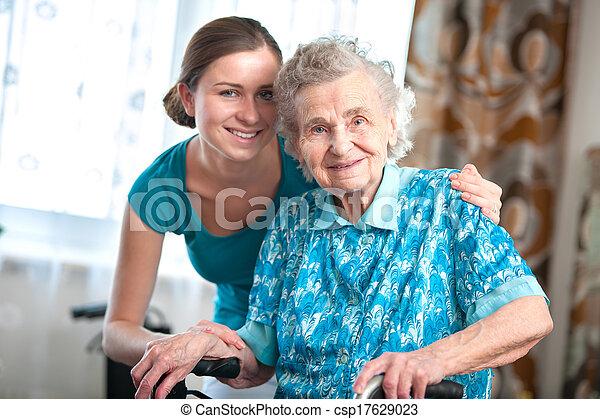 senior woman with home caregiver - csp17629023