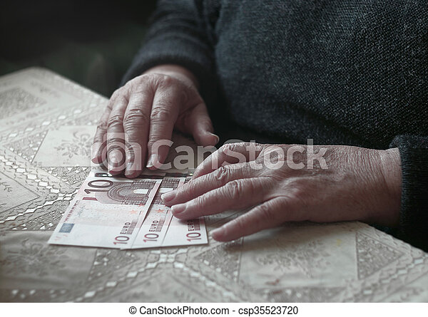 Senior woman with little euro money, toned image, colorized, selective focus, very shallow DOF - csp35523720