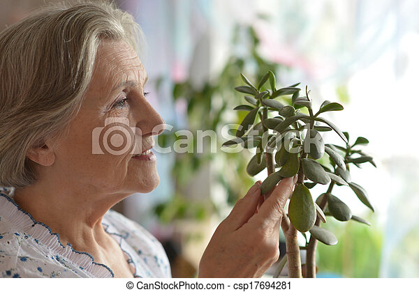 Senior woman with plant - csp17694281