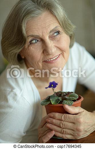 Senior woman with plant - csp17694345