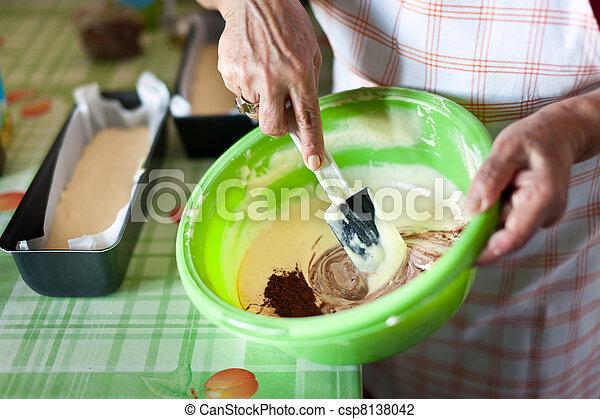 Senior woman's hands stirring cocoa cream with spatula - csp8138042