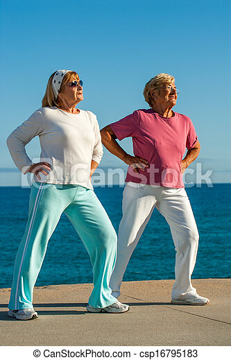 Senior women doing exercise outdoors. - csp16795183