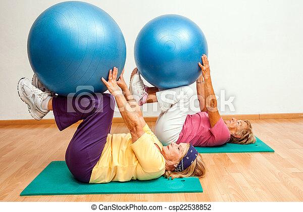 Senior women exercising with gym balls. - csp22538852