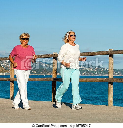 Senior women jogging together outdoors. - csp16795217
