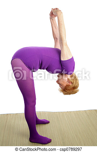 senior yoga  stretching a fit senior woman stretching as