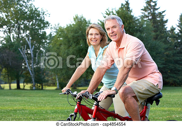seniors couple biking - csp4854554