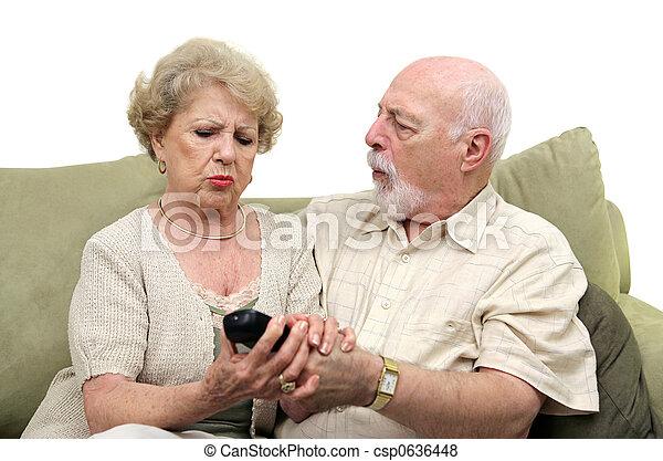 Seniors Fighting Over TV Remote - csp0636448