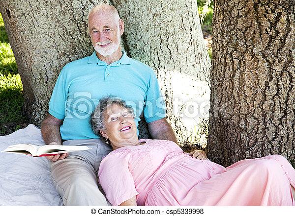 Seniors Reading Together - csp5339998